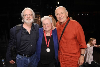 Paula Vogel flanked by librettist John Wiedman at left and playwright Terrence McNally, right