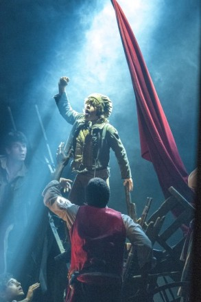 Gaten Matarazzo as Gavroche, who is shot dead in Les Miserables