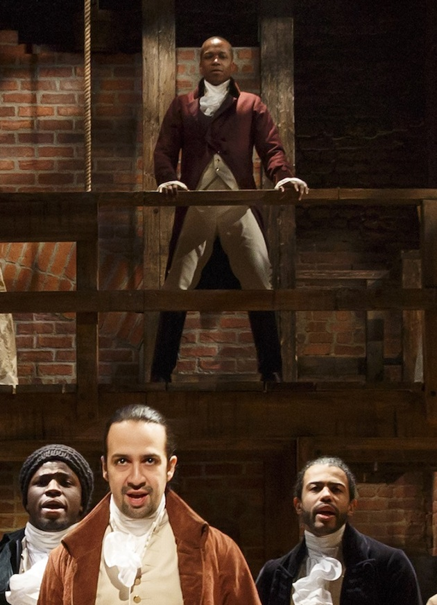 Leslie Odom Jr as Aaron Burr on ramp above Lin-Manuel Miranda as Hamilton.