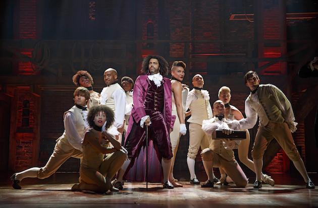 Daveed Diggs as Thomas Jefferson with ensemble of Hamilton