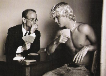 """Joel Grey posing with a male model in Duane Michel's book """"The Adventures of Constantine Cavafy, 2007"""