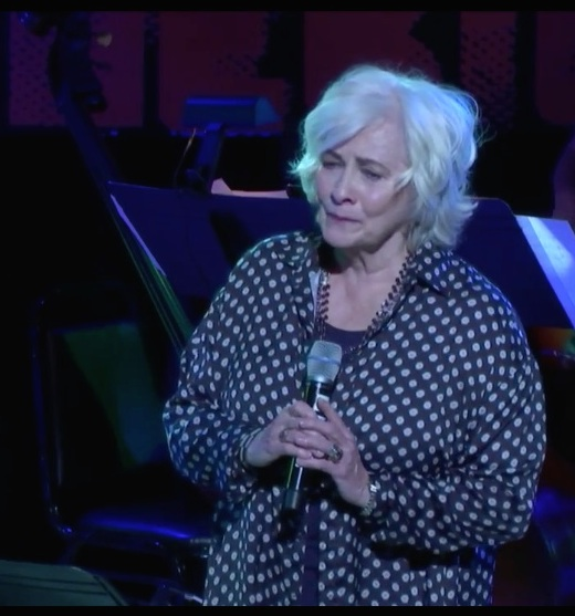Betty Buckley sang: Don't give up 'cause you have friends Don't give up You're not beaten yet Don't give up I know you can make it good