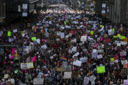 Demonstrators hold signs and march towards Trump Tower during the Women's March in New York, , on Saturday, Jan. 21, 2017. Photographer: Jeenah Moon/Bloomberg via Getty Images