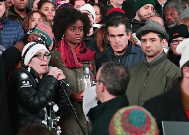 Tina Landau (with microphone) speaking at the Ghostlight Project in Times Square