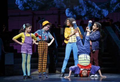 (L to R) Ruth Righi (Kathy), Anthony Rosenthal (Johnny), and Nicole Wildy and Jaiya Chetram holding Eduardo Hernandez upside down (Pierre)